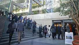 People wait in line to attend the bail hearing of Huawei Technologies Chief Financial Officer Meng W