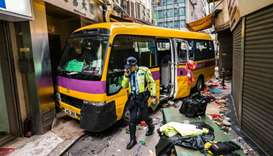 Police investigate after an empty schoolbus crashed in the North Point district of Hong Kong