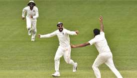 Captain Virat Kohli (centre) and Ravichandran Ashwin (right) celebrate India's victory over Australi