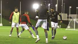 Al Duhail striker Youssef El Arabi (right)