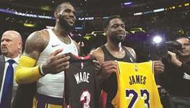 James wins final duel with Wade as Lakers roll on