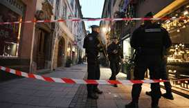 Police officers patrol the streets searching for the gunman who opened fire near a Christmas market