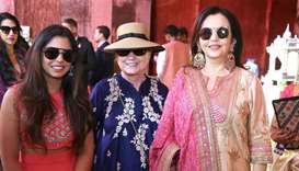 Former US Secretary of State Hillary Clinton poses with Isha Ambani daughter of Mukesh Ambani, Chair