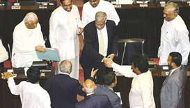 Lanka parliament demands ousted PM is restored