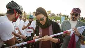 Sheikha Moza participates in QF stage of Flag Relay