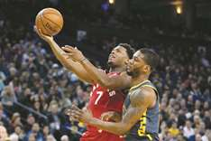Lowry, Ibaka power Raptors in lopsided win over Warriors