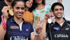 Indian badminton players Saina Nehwal (L) and Parupalli Kashyap pose with their New Delhi Commonweal
