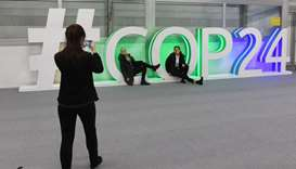 Participants pose for a picture during the final session of the COP24 summit on climate change in Ka