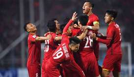 Vietnam's players celebrate scoring a goal during the AFF Suzuki Cup 2018 final football match betwe