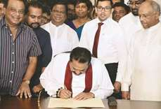 Lanka power struggle ends as Rajapakse bows out