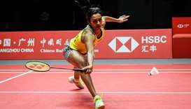 Sindhu Pusarla of India hits a return against Ratchanok Intanon of Thailand