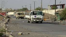 Yemeni pro-government forces steer their cars in the Houthi-held Red Sea port city of Hodeidah