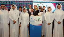 Qamco and the Qatar Stock Exchange officials after the listing. Investors expect a bullish trend.