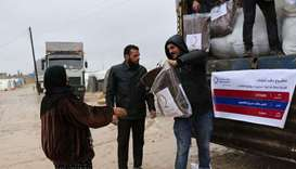 QC distributes winter aid to displaced Syrians