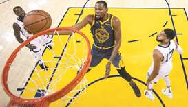 Durant and Curry lead Warriors over Grizzlies