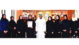 The award-winning Al-Bairaq team members with QU president Dr Hassan Rashid al-Derham.