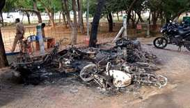 FILE PHOTO: Charred vehicles are pictured near a government office, after at least 13 people were ki