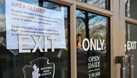 A sign is displayed on a government building that is closed because of a US government shutdown in W