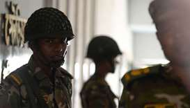 Bangladesh Army soldiers stand guard at a temporary base set up in Dhaka