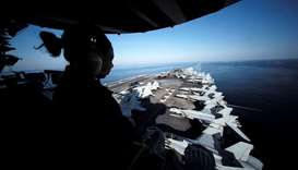 Iran says ready to respond, but US aircraft carrier no threat