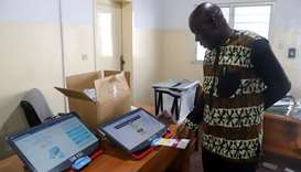 A worker of Congo's National Independent Electoral Commission (CENI), tests a voting machine ahead o