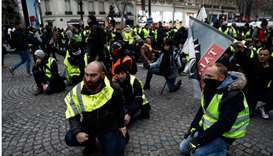 Protesters sit in the street on Champs-Elysees Avenue in Paris