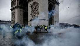 Demonstrators clash with riot police at the Arc de Triomphe during a protest of Yellow vests (Gilets