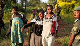 A woman reacts after five other women were killed in Paida, near Beni, North Kivu Province of Democr