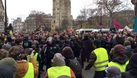 French CRS riot police clash with protesters in Paris, France