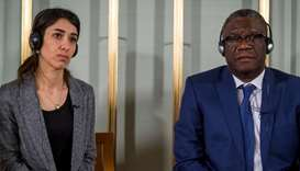 Nobel peace prize laureates Nadia Murad and Denis Mukwege attend a news conference at the Nobel Inst