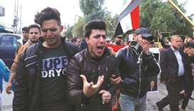 Mourners react during the funeral of the Iraqi civil activist Fahem al-Tai, who was killed overnight
