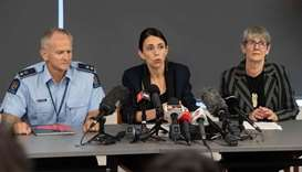 Prime Minister of New Zealand Jacinda Ardern (C) with New Zealand Police Superintendent Bruce Bird (
