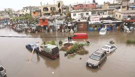 Cars are stuck after breaking down on a flooded road due to heavy rain, at the southern entrance of