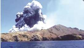 Smoke from the volcanic eruption of Whakaari, also known as White Island, is pictured from a boat, N