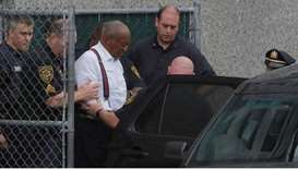 Actor and comedian Bill Cosby leaves the Montgomery County Courthouse in handcuffs after sentencing