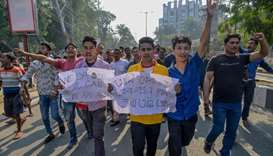 Citizens shout slogans as they take part in a protest during the strike called by North East Student