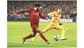 Liverpool's Mohamed Salah (left) scores against Salzburg in the  Champions League Group E match yest