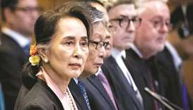 Myanmar's State Counsellor Aung San Suu Kyi stands before UN's International Court of Justice in the