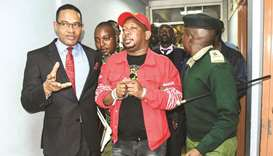 Governor Mike Sonko (centre) is escorted after the High Court granted him bail at the Milimani law c