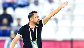 Al Sadd's head coach Xavi Hernandez reacts during the FIFA Club World Cup Qatar first round match ag