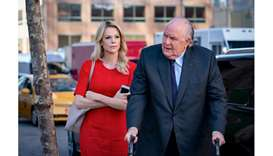 ACTION: Charlize Theron as Megyn Kelly and John Lithgow as Roger Ailes in Bombshell.