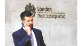 A commuter walks past the London Stock Exchange building. The FTSE 100 jumped 1% to 7,287.00 points