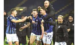 Atalanta's players celebrate after qualifying for the Champions League last 16 after a win over Shak