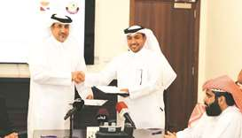 Executive Director of Qatar Olympic Academy Saif al-Nuaimi (left) and the Director of the Sports 