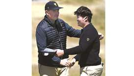 International Team captain Ernie Els of South Africa (left) celebrates with An Byeong-hun during day