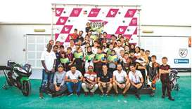 Young riders pose after the first round of the QMA Challenge at the Losail Circuit Sports Club.