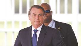 President Jair Bolsonaro leaves the Alvorada Palace in Brasilia, Brazil, yesterday.
