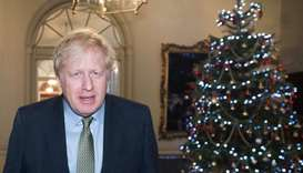 Britain's Prime Minister Boris Johnson leaves Downing Street in London on December 13, 2019 for Buck