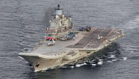 Russian aircraft carrier Admiral Kuznetsov passing the Norwegian island of Andoya in the internation