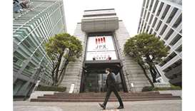 A pedestrian walks past the Tokyo Stock Exchange building in Japan. The Nikkei 225 closed up 2.6% to